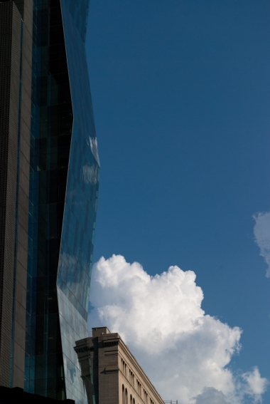 A cloud and a skyscraper