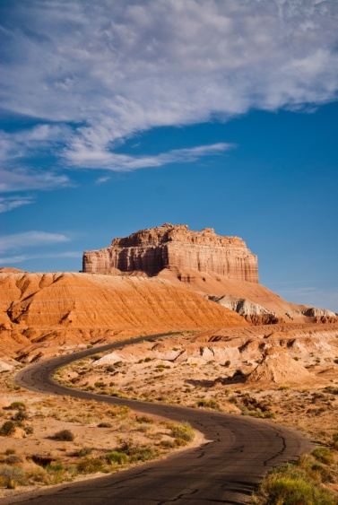 A scene with road and Wild Horse Butte